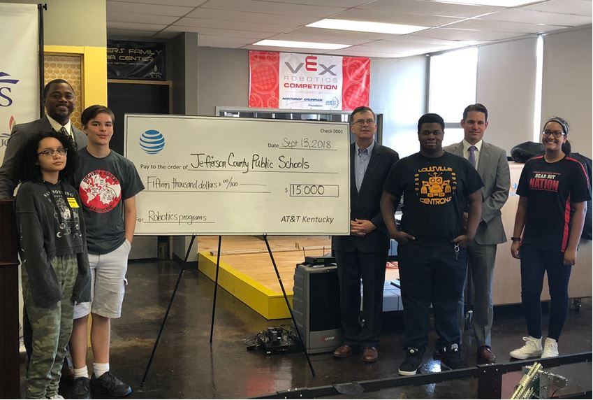 students stand with $15,000 check that was donated from AT&T Kentucky