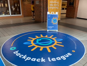 Backpack Leauge Logo on the floor of Male High
