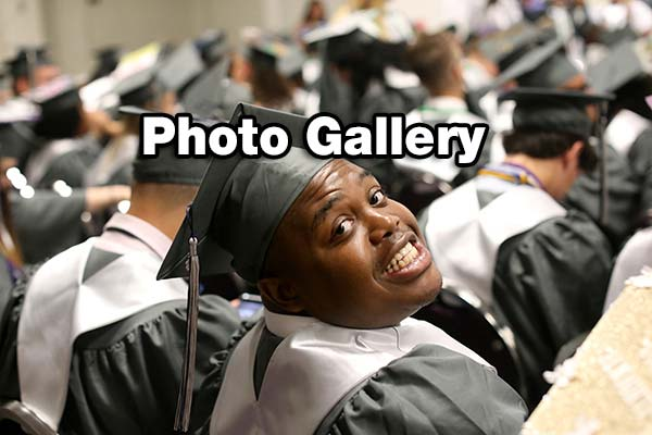 "student in cap and gone turns toward camera, text ""Photo Gallery\"""