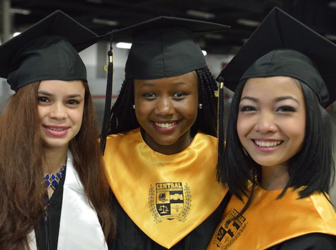 three female students wearing graduate caps and gowns